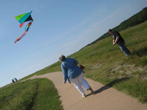 Mom and Jim flying a kite at Kittyhawk
